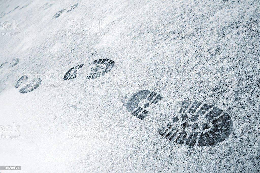 Footprints in the snow at wintertime stock photo