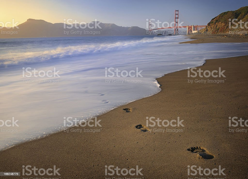 Footprints leading to Golden Gate Bridge stock photo