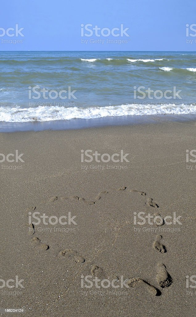 Footprints making a Heart Shape (Portrait Version) royalty-free stock photo
