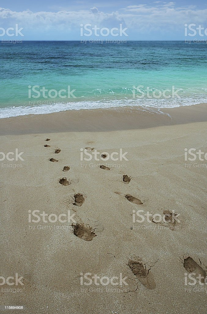 Footprints on a tropical beach. royalty-free stock photo