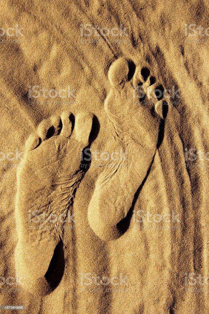 Footprints on sand royalty-free stock photo