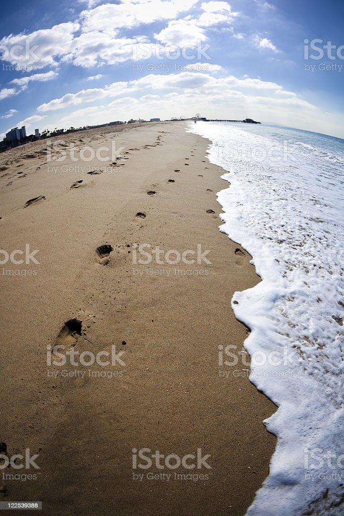 Footprints on the beach royalty-free stock photo