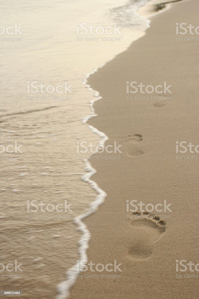 Footprints on the beach stock photo