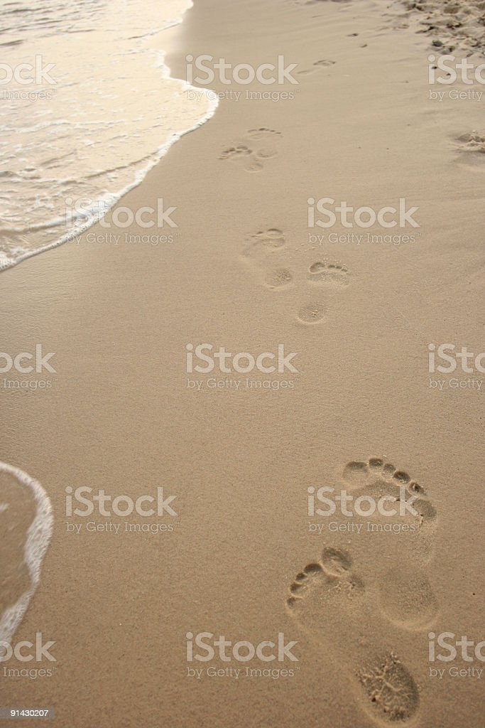 Footprints on the beach royalty-free stock photo