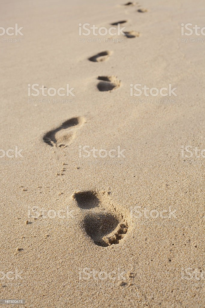 Footprints on the beach sand stock photo