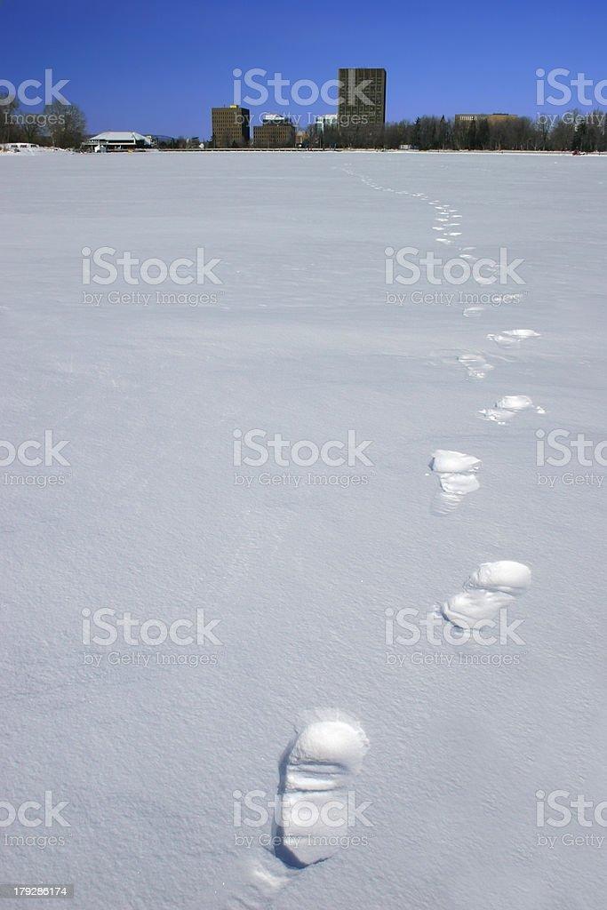 Footprints on the Frozen Lake stock photo