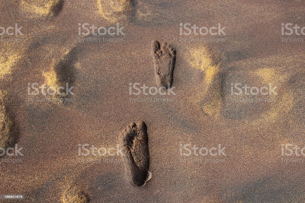 footprints on the golden sand on the beach royalty-free stock photo