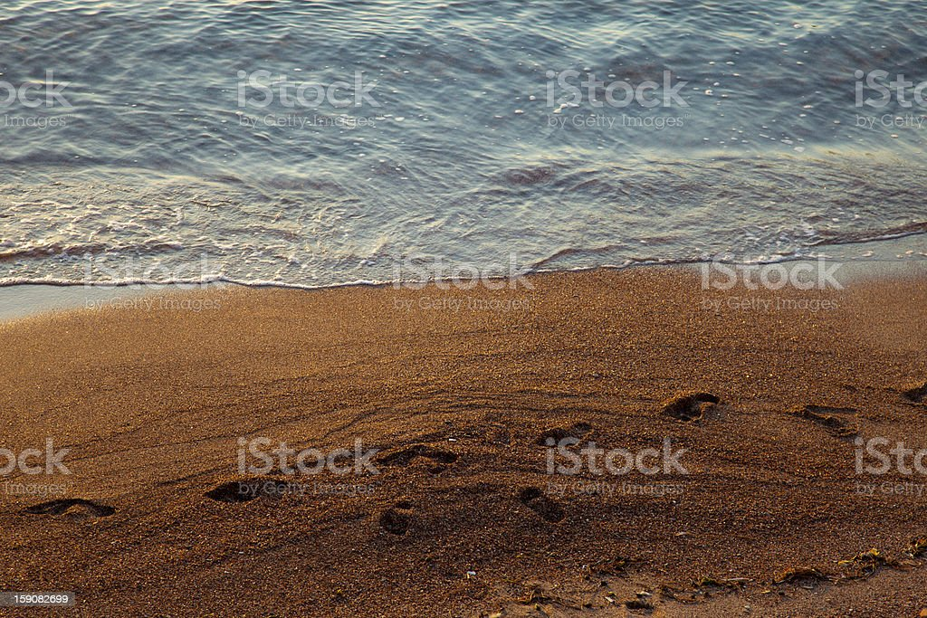 Footprints on the sand royalty-free stock photo