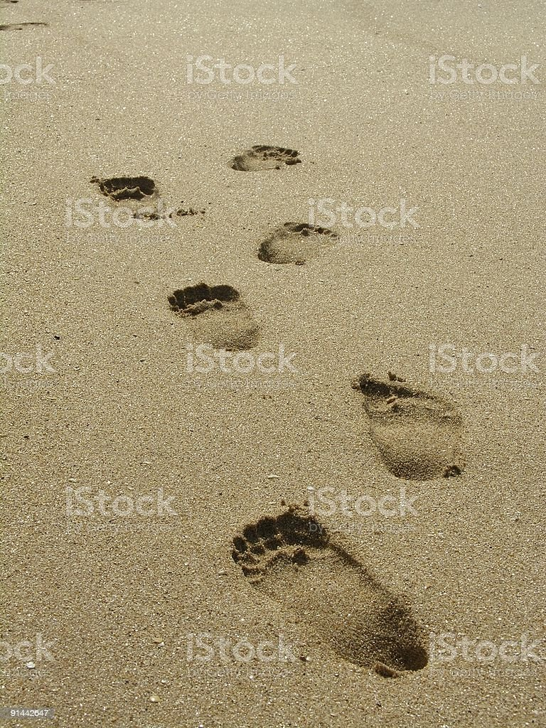 Footprints on the sand (beach) royalty-free stock photo