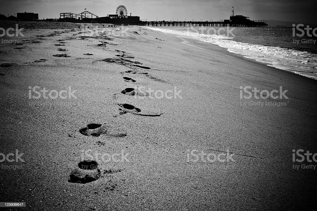 Footprints on the Santa Monica Beach in Black and White royalty-free stock photo