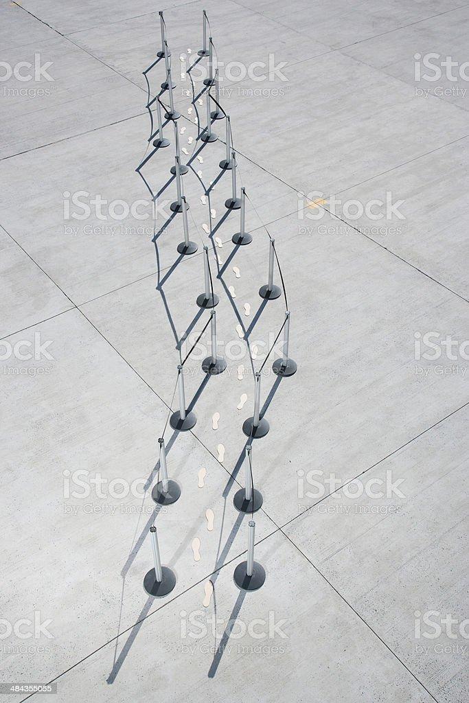 Footprints walking along cordon posts stock photo