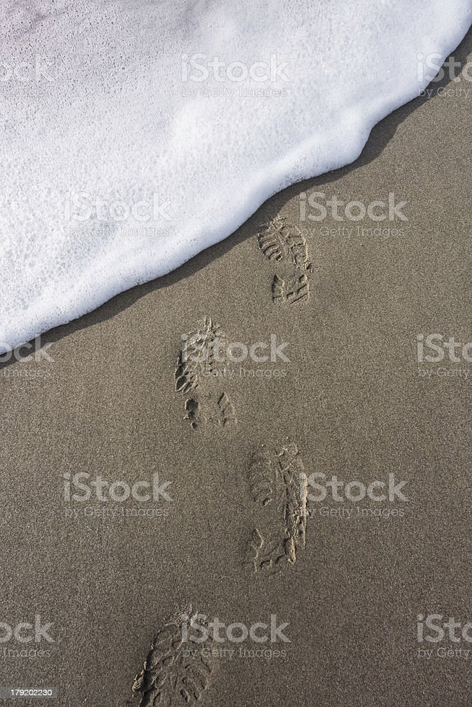 Footprints washed away stock photo