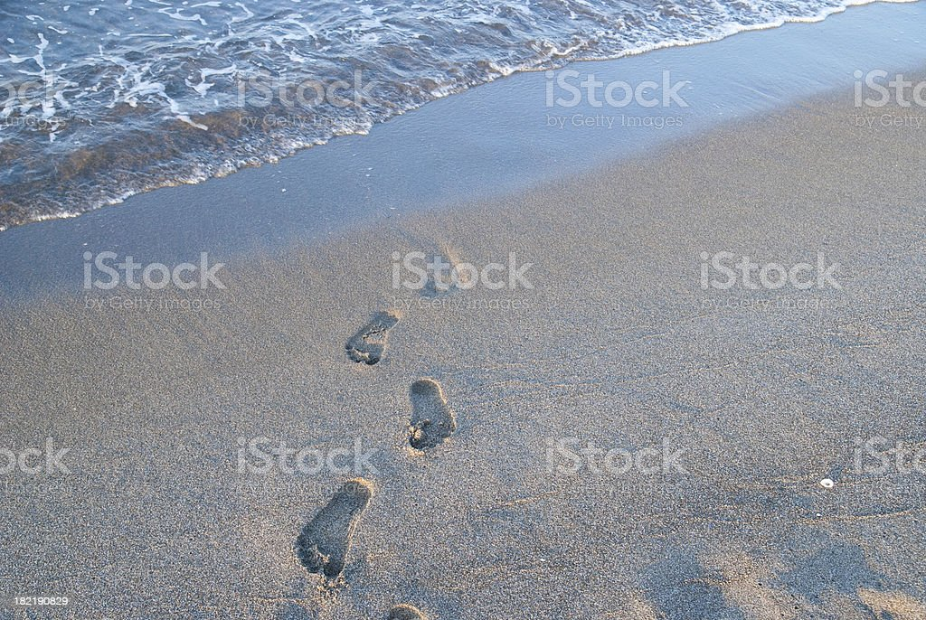 footsteps at beach horizontal background stock photo