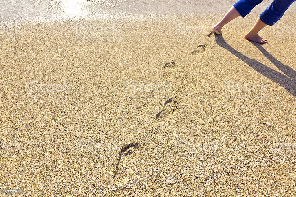 footsteps at the beach royalty-free stock photo