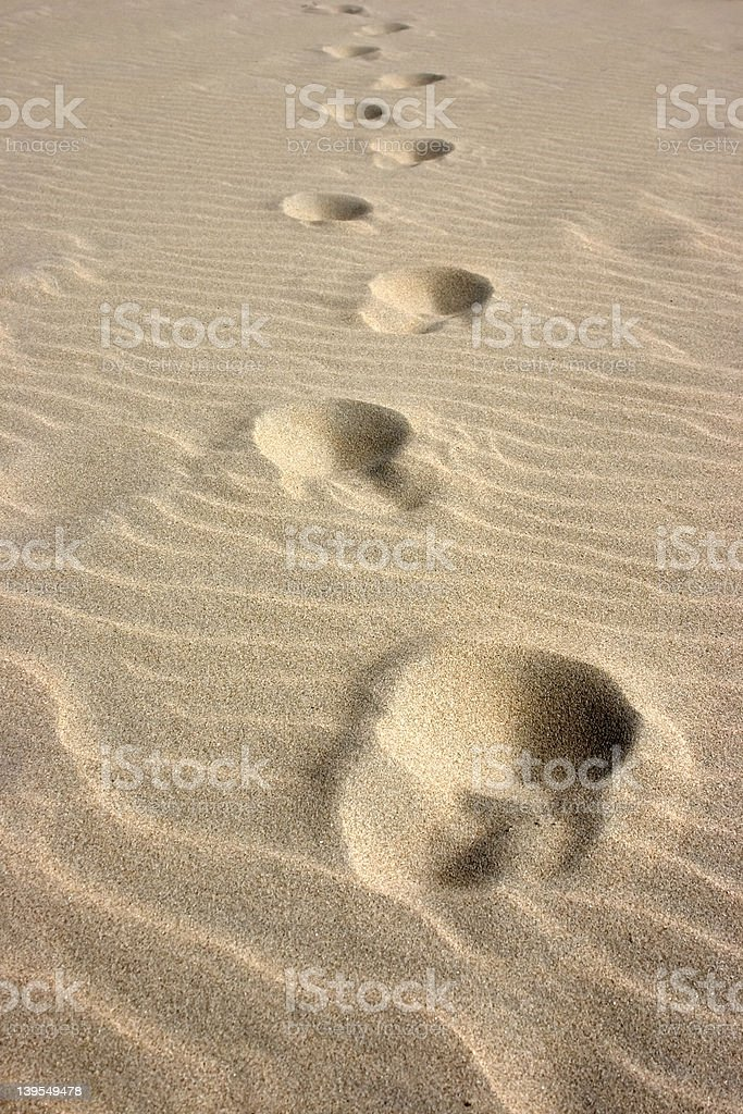 Footsteps in the sand royalty-free stock photo
