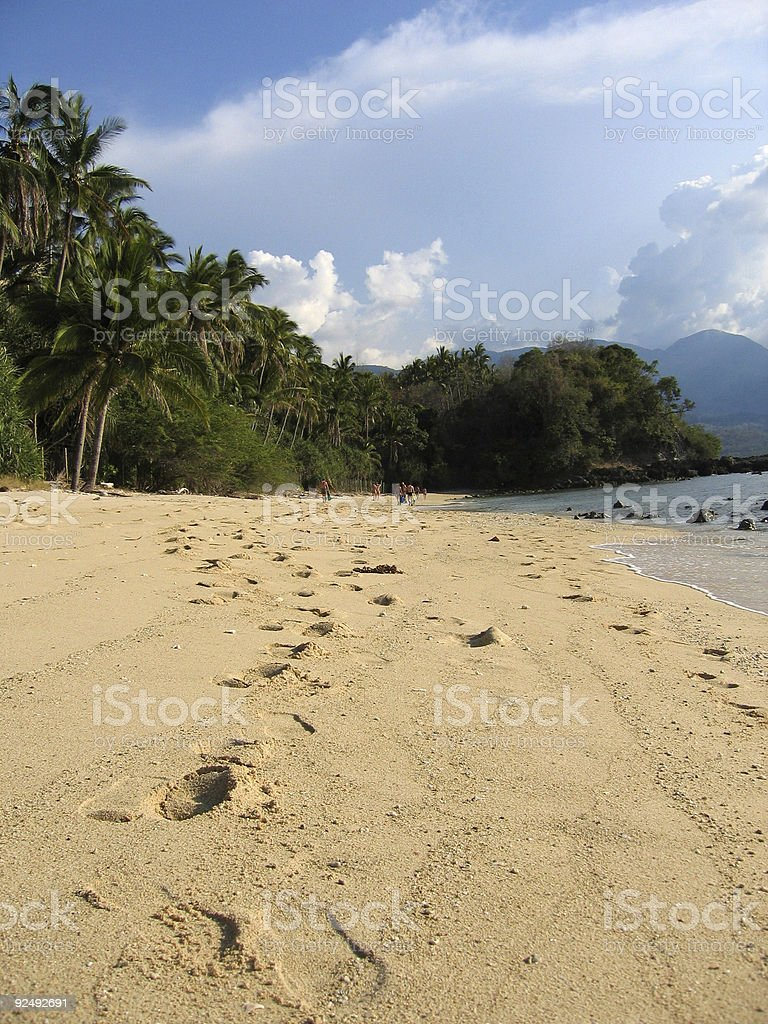 footsteps in the sand tropical beach philippines stock photo
