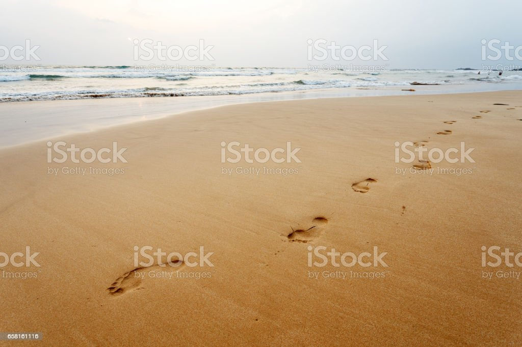 Footsteps on the beach, background stock photo