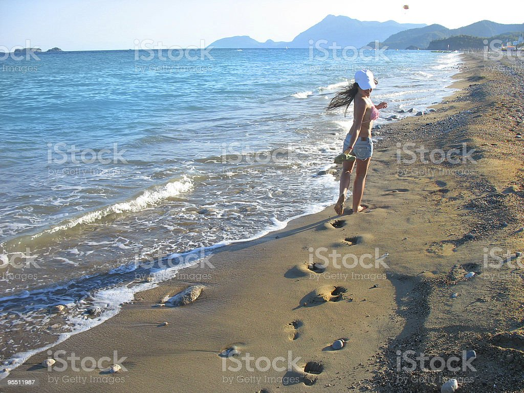 Footsteps on the beach royalty-free stock photo