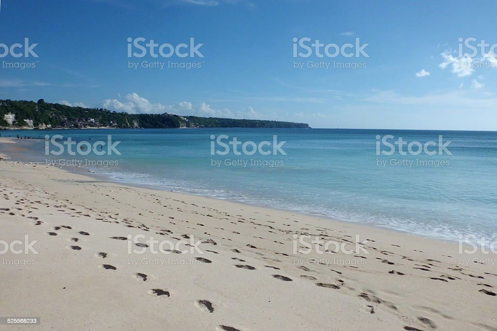 Footsteps on the sand close to the ocean, Dreamland beach, Bali royalty-free stock photo