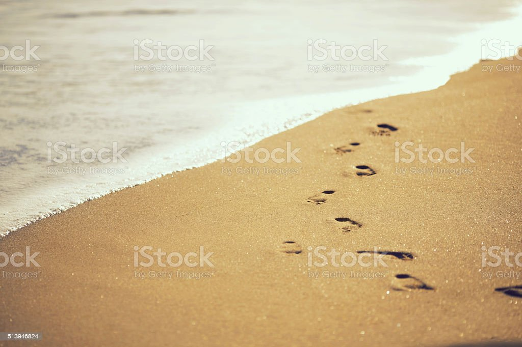 Footsteps on the sand stock photo