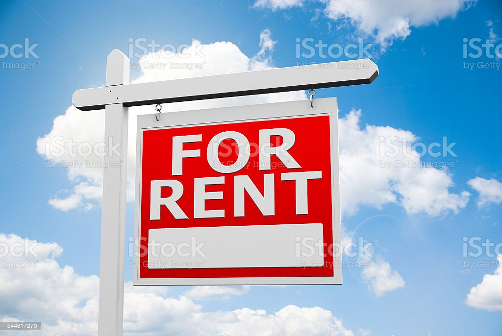 For Rent signpost on sky stock photo