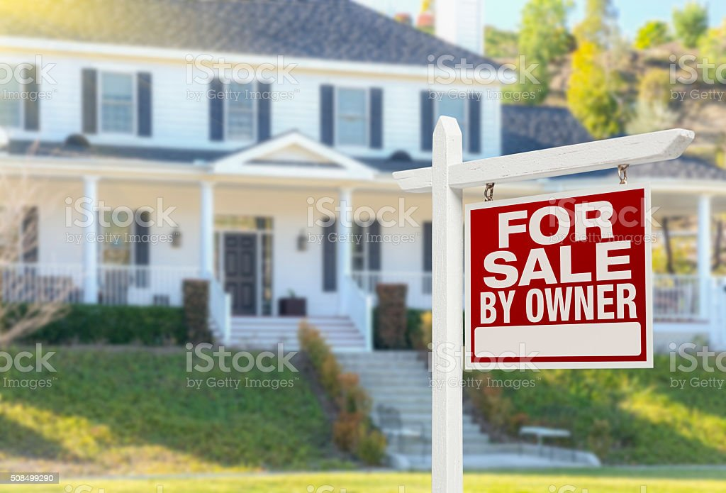 For Sale By Owner Real Estate Sign and House stock photo