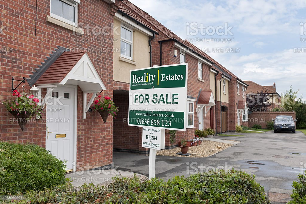 For Sale Sign and Property stock photo