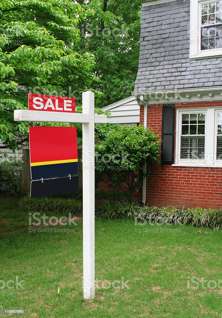 for sale sign in front of a brick house royalty-free stock photo