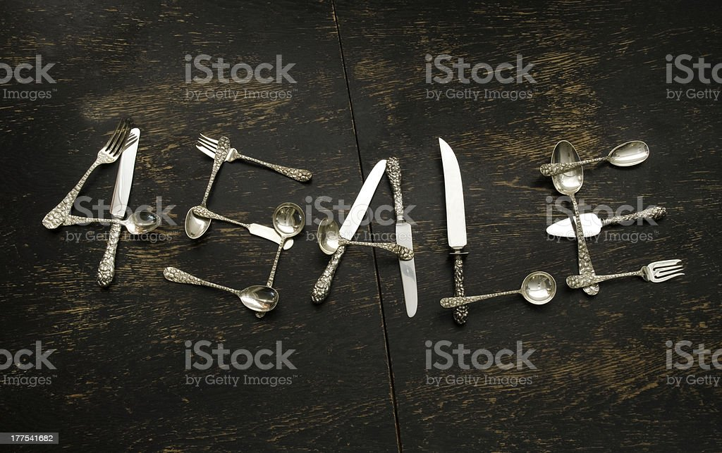 For Sale sign made of sterling silver flatware royalty-free stock photo