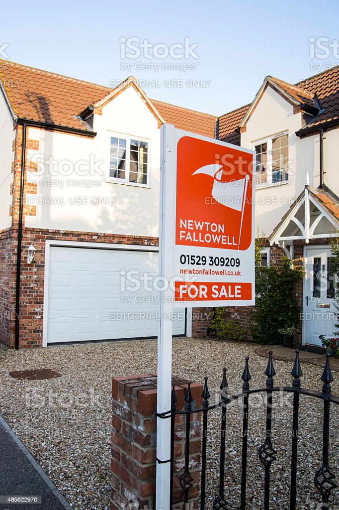 For sale sign outside large family home in UK England royalty-free stock photo