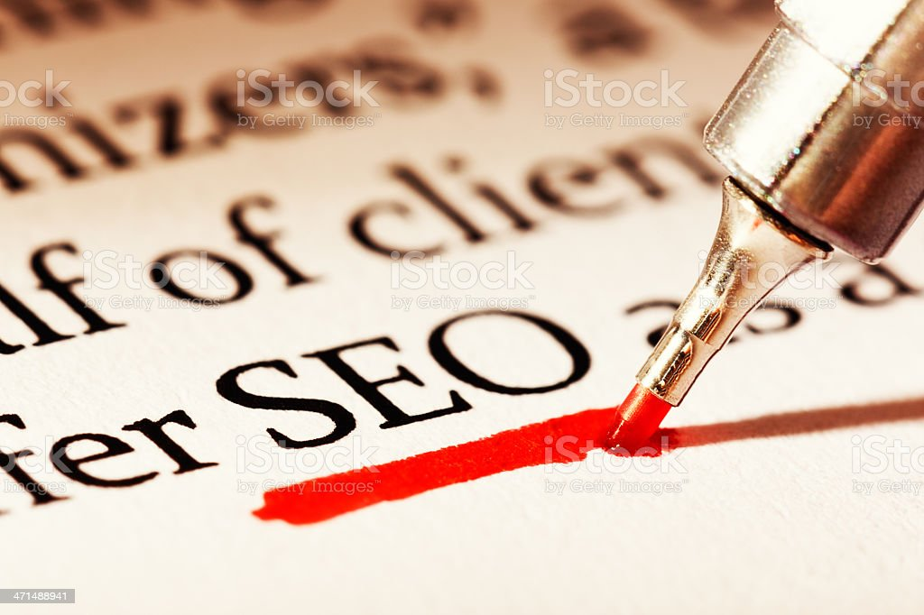 SEO, for Search Engine Optimization, underlined in red on document stock photo