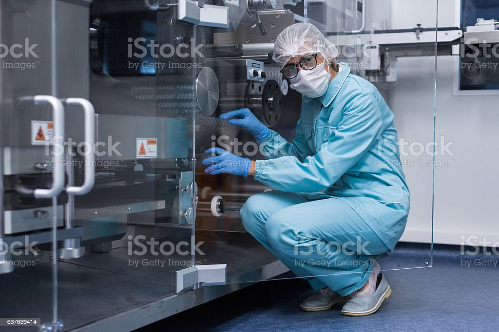 for service engineer visits the high-tech equipment stock photo