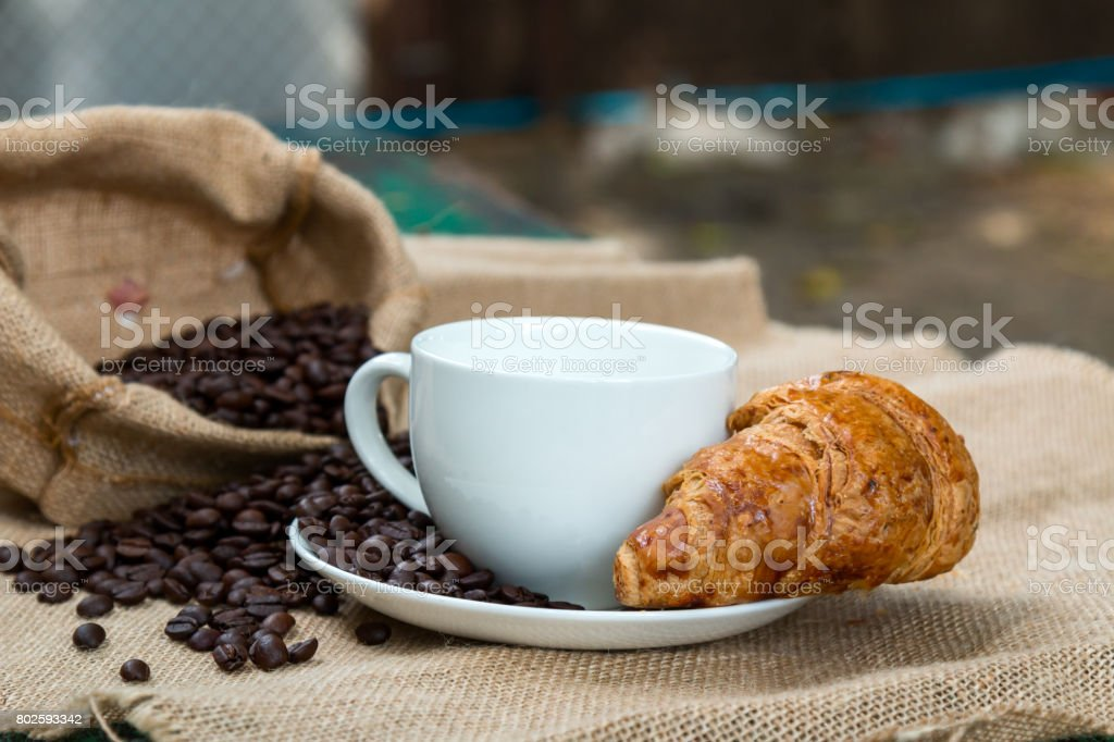 For the breakfast time by drinking coffee with Croissant to let body wake up. stock photo