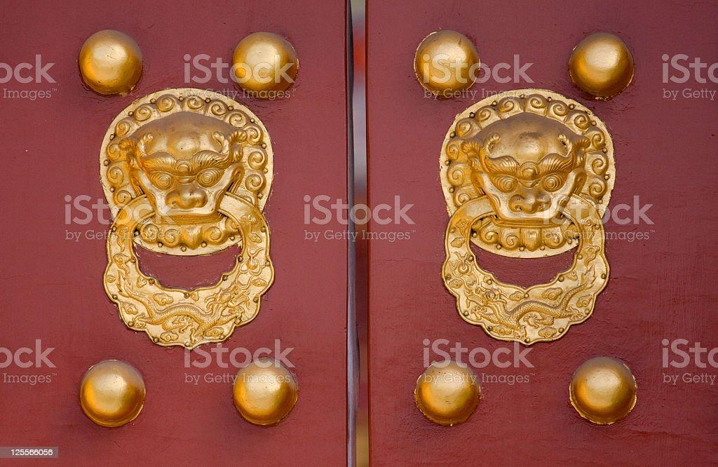 Forbidden City Ancient Door Knockers stock photo