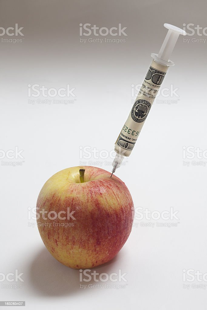 Forbidden Fruit - Apple Injected with Money royalty-free stock photo