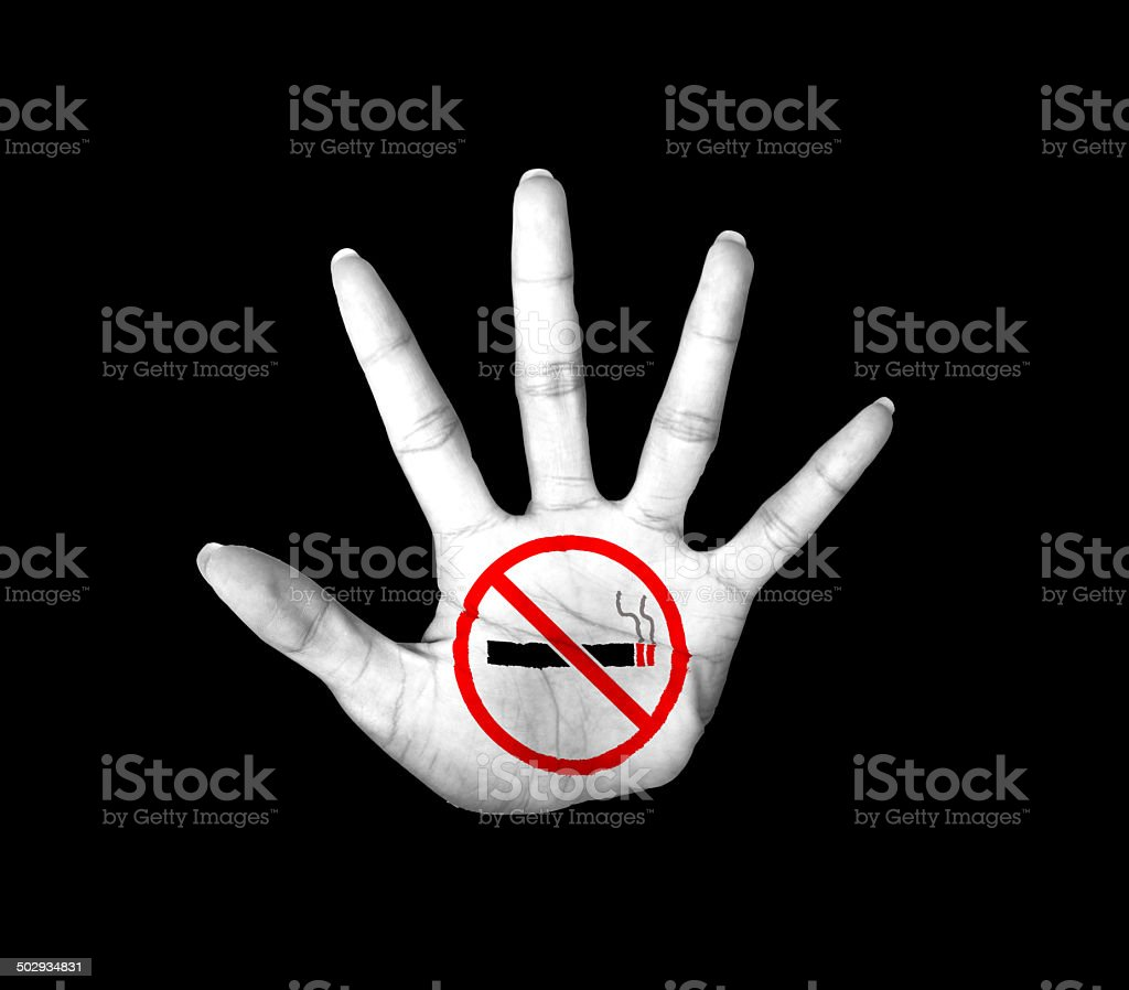 forbidden sign on Open hand, No smoking sign painted stock photo
