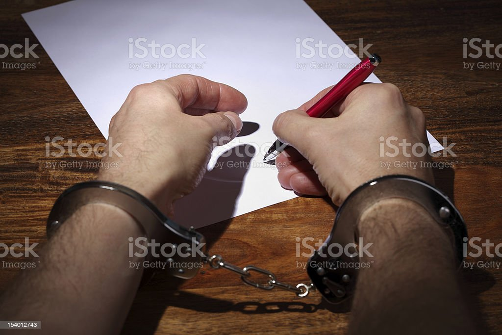 Forced confession or agreement stock photo