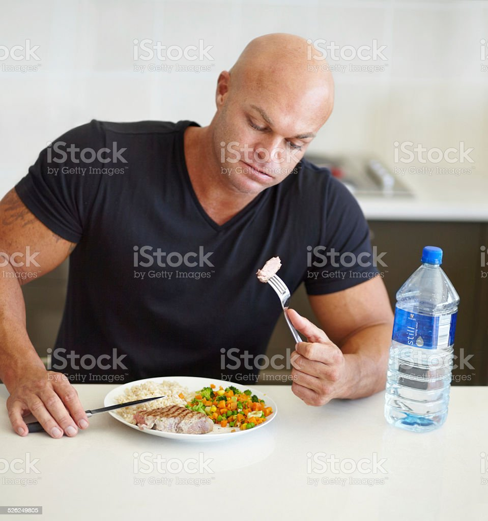 Forcing down his last bite stock photo