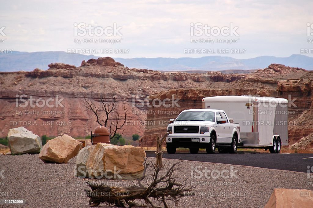 Ford F-150 EcoBoost parked with trailer stock photo