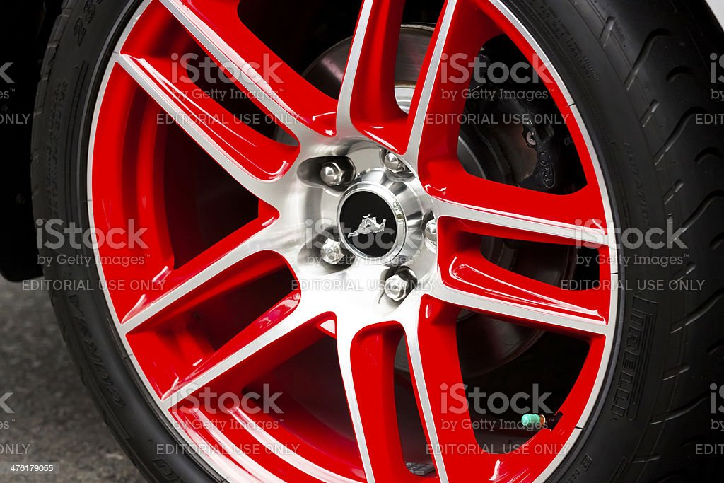 Ford Mustang red alloy wheel stock photo