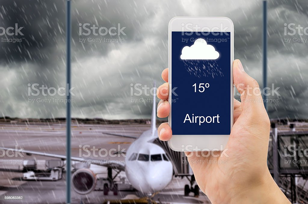 forecast weather with smartphone at the airport stock photo