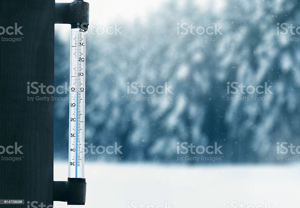 forecasting winter weather thermometer on glass window with forest background stock photo