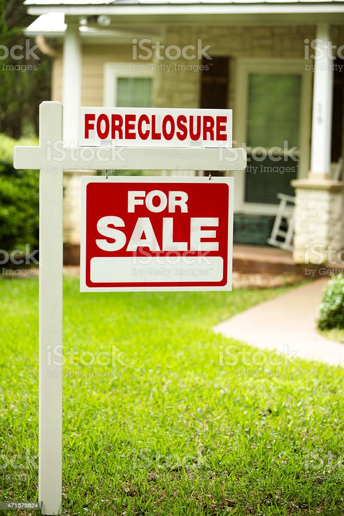 Foreclosure, house for sale sign. Front yard of home. Nobody. stock photo