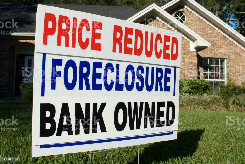 Foreclosure, Price Reduced, Bank Owned Yard Sign royalty-free stock photo
