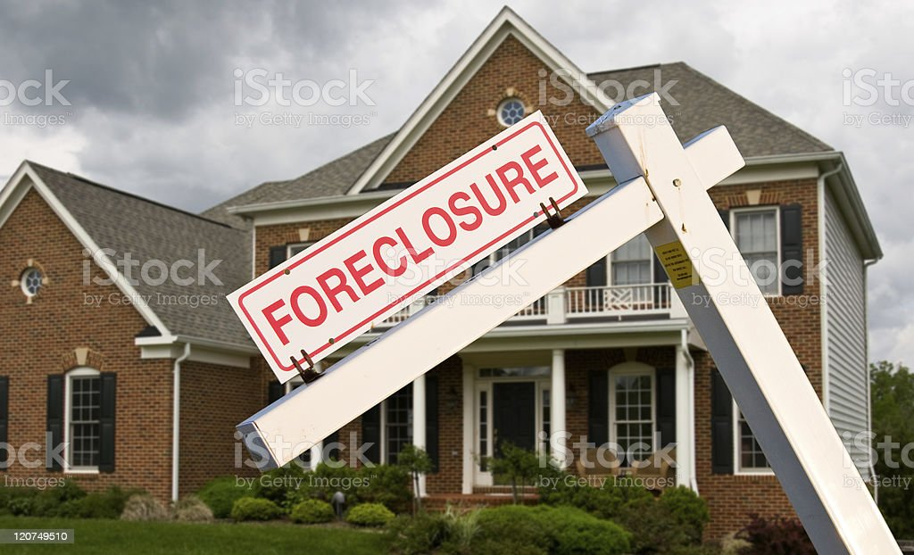 Foreclosure sign in front on modern house stock photo