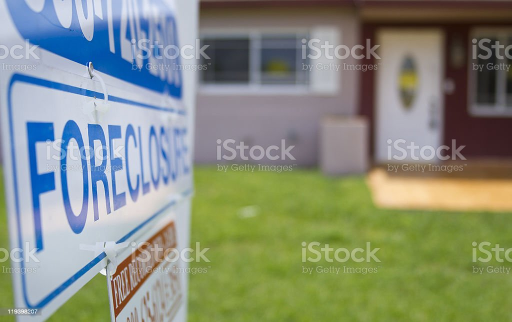 foreclosure sign outside a condemned property stock photo