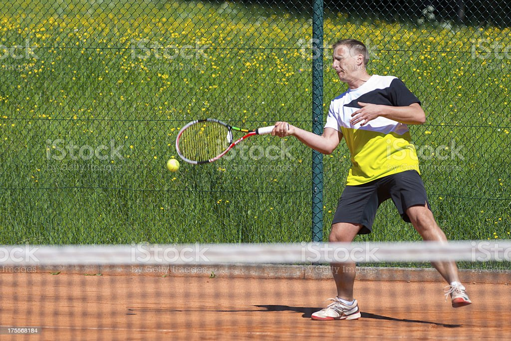 forehand of male tennis player royalty-free stock photo