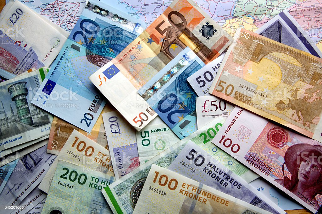 Foreign Currency Scattered Over A Map stock photo