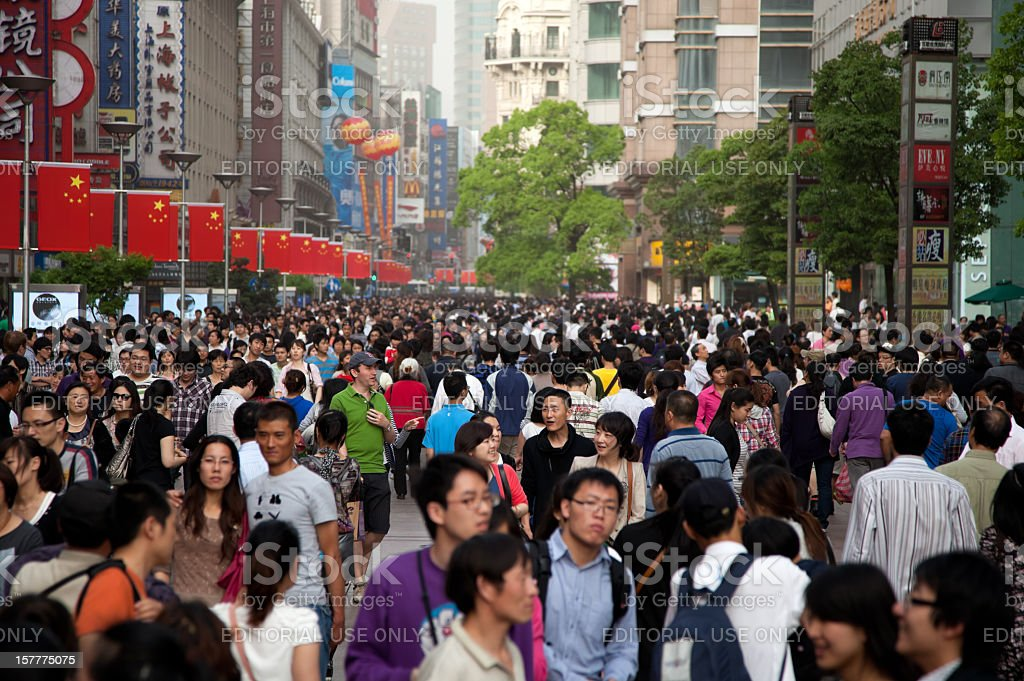 Foreign tourist lost in middle of Chinese crowd, Shanghai, China royalty-free stock photo