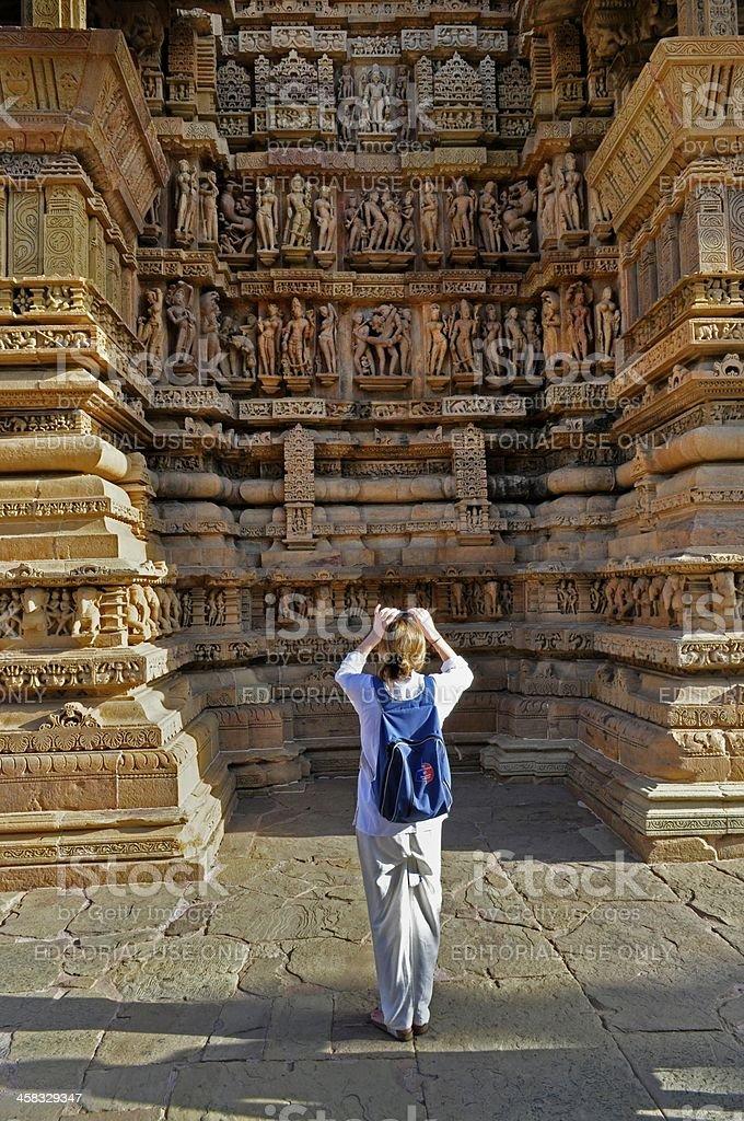 Foreign visitor at Lakshmana Western Temple of Khajuraho, stock photo